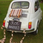 Vintage floral suitcase, brown paper chains, Just Married 'blackboard' sign